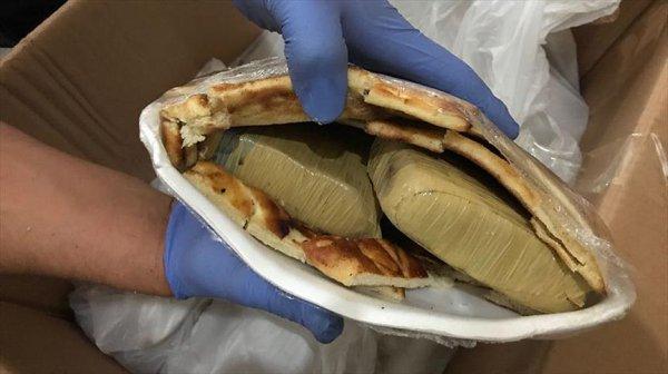 Çöreklerin arasından 26 kilogram eroin çıktı